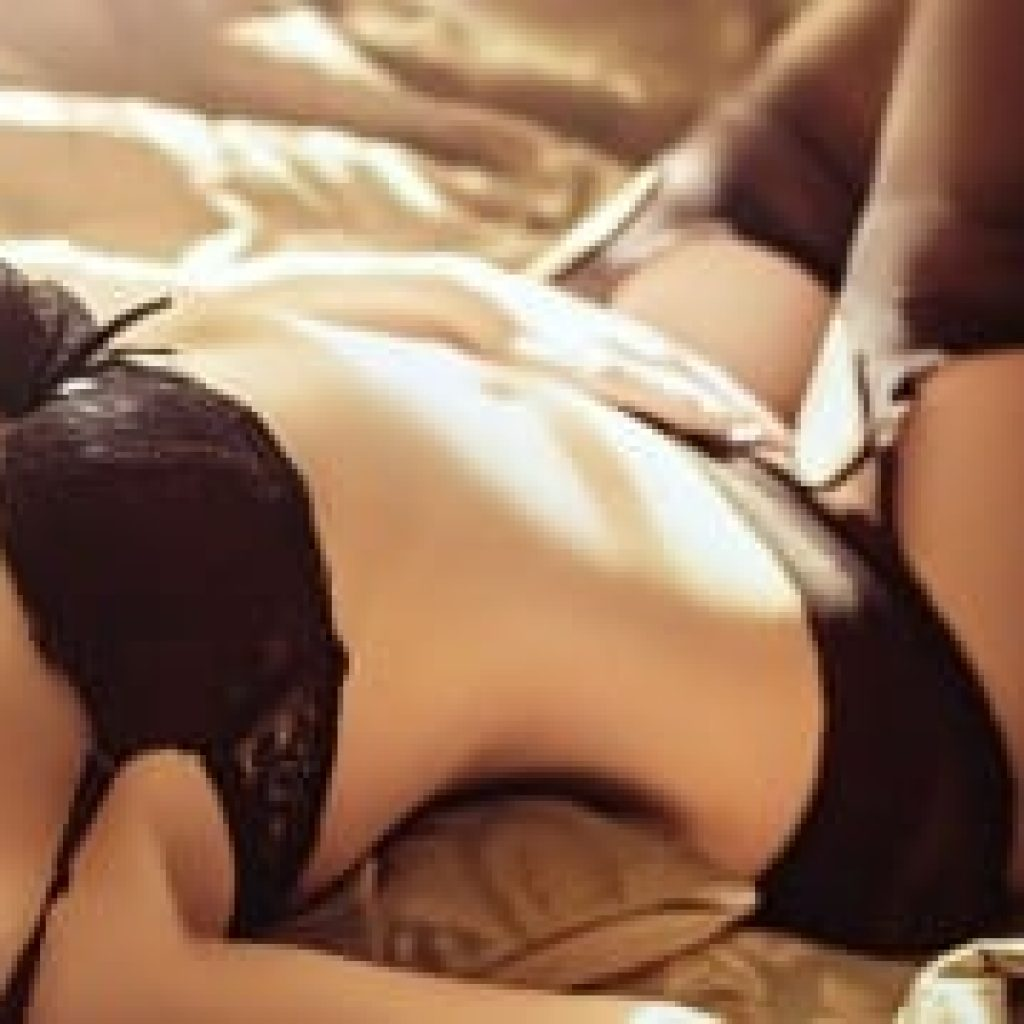 Sexual woman laying down on bed in classy lingerie