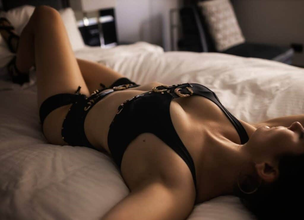Sexy brunette on bed